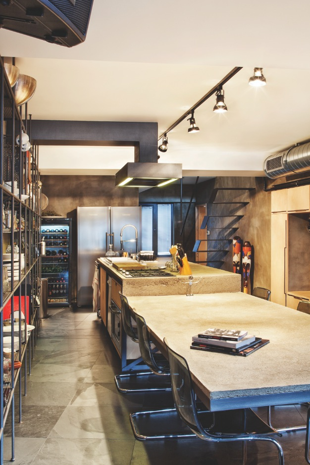Spacious Modern Kitchen - Karakoy loft uses rich wood features and creative industrial elements