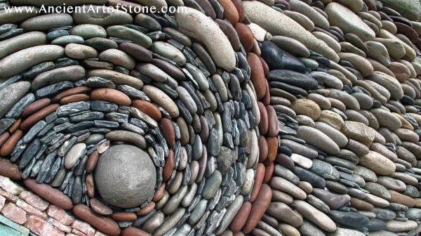 Spiral designs are common in the stone pieces, lending each piece its own fluidity.