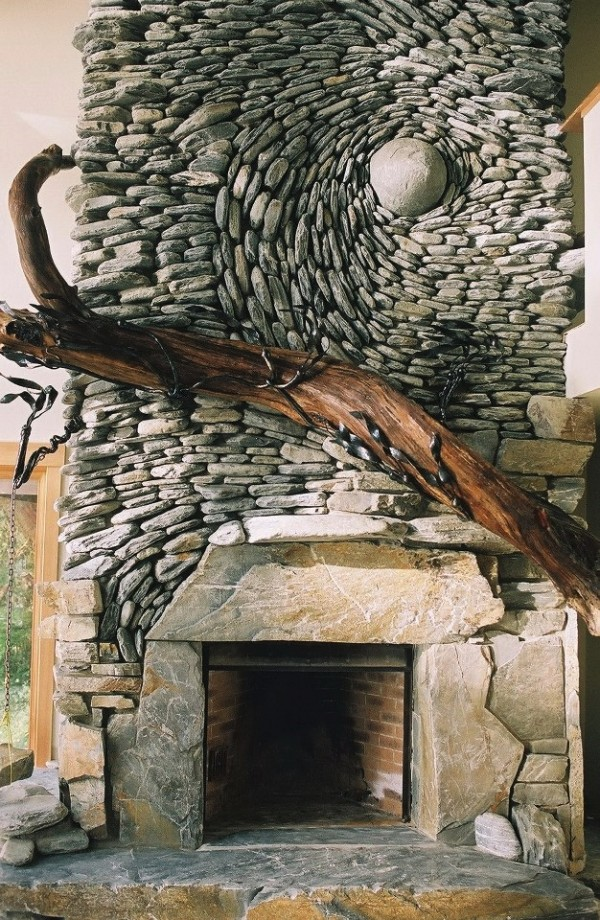 Multiple stone works plus a massive wooden sculpture is make this fireplace something more than a focal point.