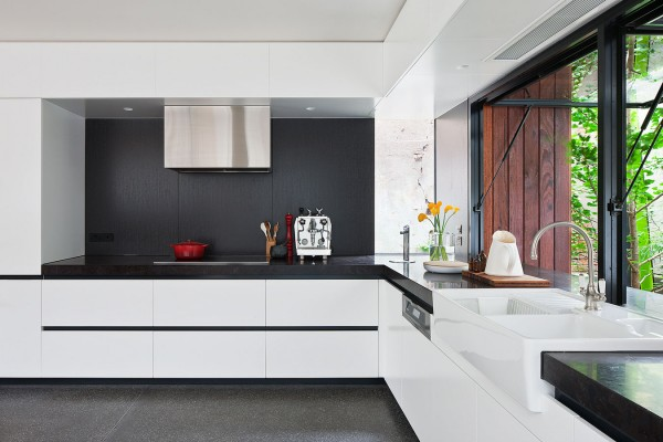 The kitchen is glorious with its black and white motif and contemporary fixtures. Cooking in an historic kitchen might sound quaint, but could get old quickly. Not so in here.