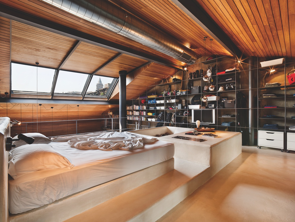 Karakoy loft uses rich wood features and creative for Wooden bed interior design