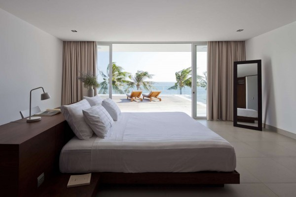 But even those bedrooms that do not open directly onto the patio have incredible ocean views from their floor-to-ceiling windows.