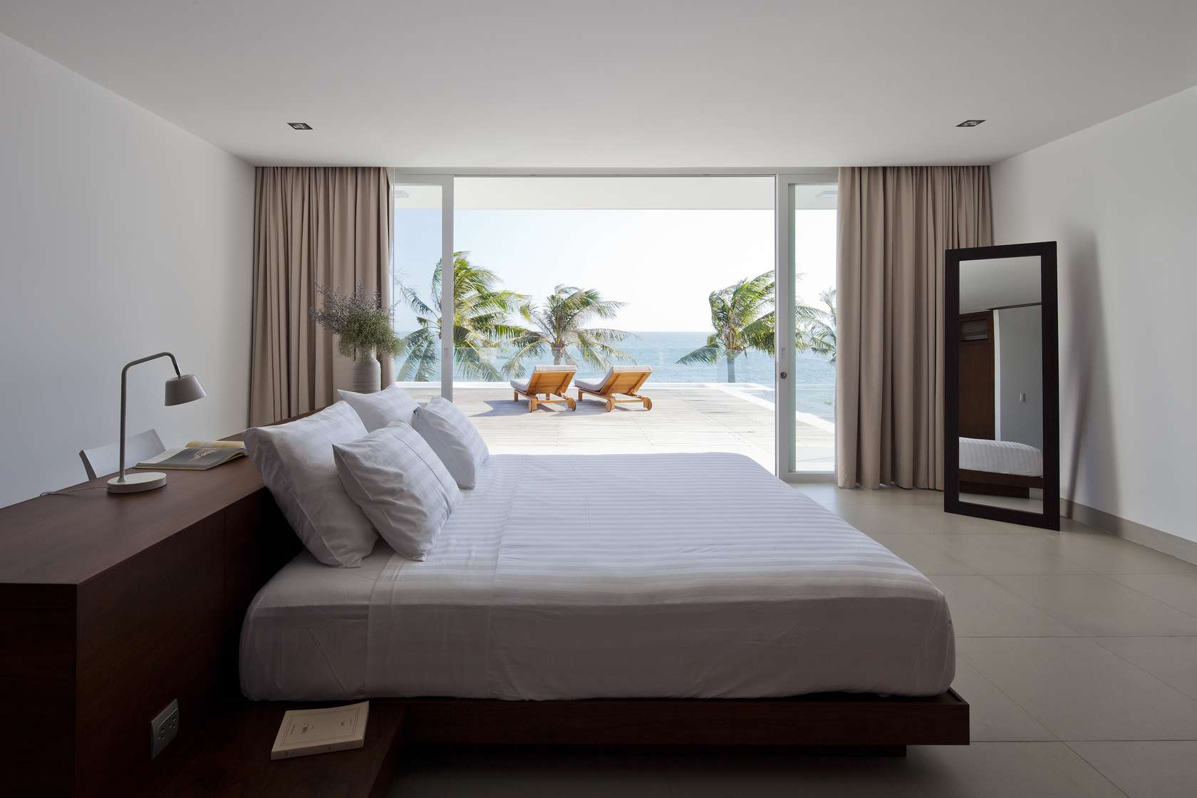 private beach villas offer spectacular ocean views and luxurious interiors. Black Bedroom Furniture Sets. Home Design Ideas