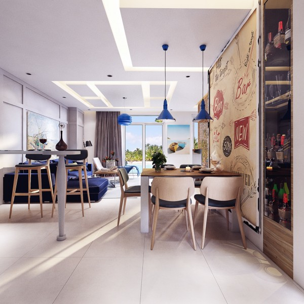 """Other carefully chosen elements such as the graphic """"Bar"""" wallpaper as well as the sleek bar cabinet make it clear that this is a house where parties and relaxing are not just common - they're expected"""
