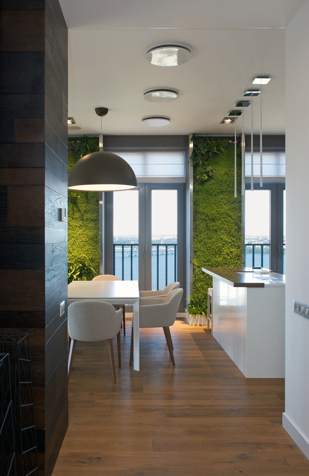 Vertical garden walls add life to apartment interior Modern apartment interior design