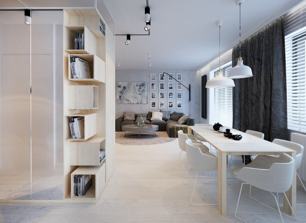Creative, custom shelving built in light wood provides storage and also hides away clutter.
