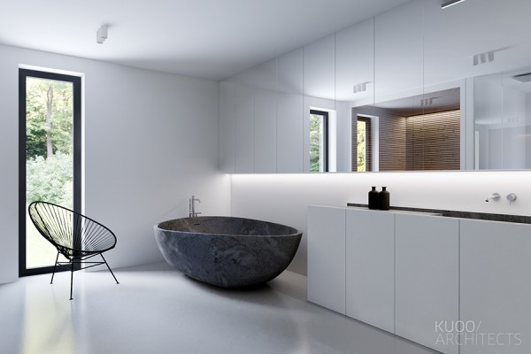 A deep slate tub is perhaps the opposite of the coveted clawfoot, but has its own ultramodern appeal.