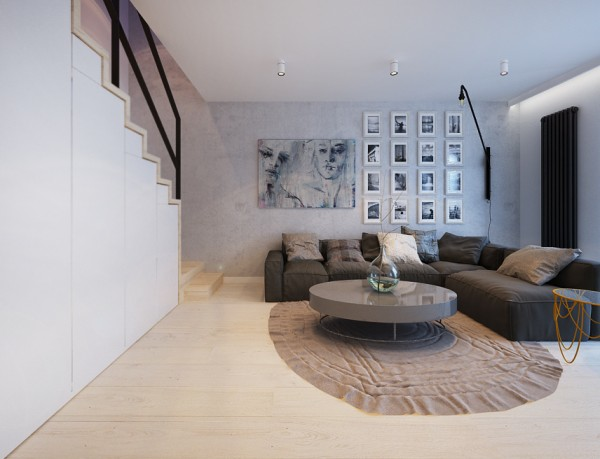 The first apartment, in Wrocław, uses an open floorplan to make the entire space feel airy.