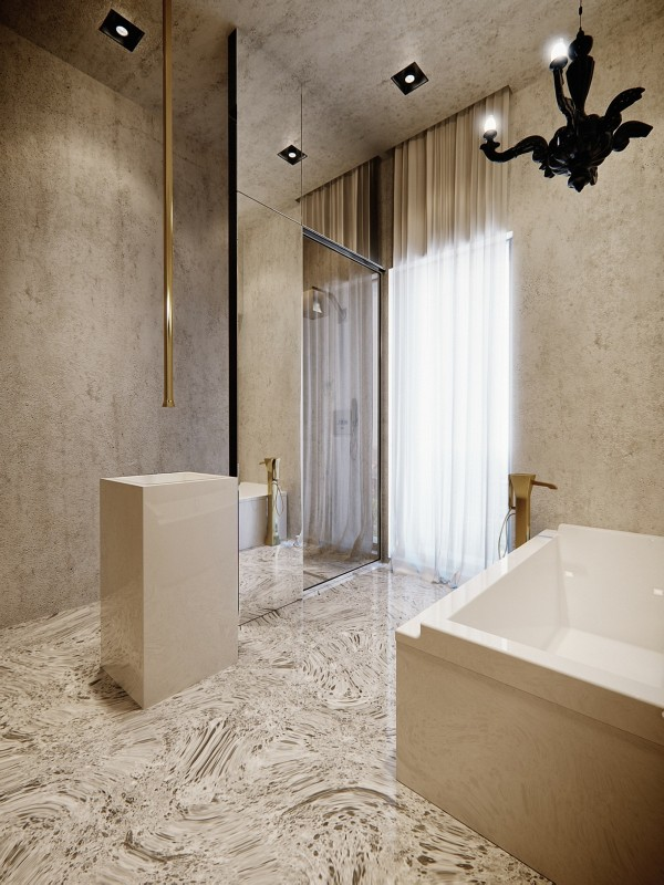 The spacious bath is sleek with a huge bath and subtle gold accents.