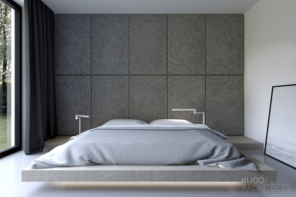 A low platform bed with a clever bedside table design give the room a focus and that focus is relaxation.