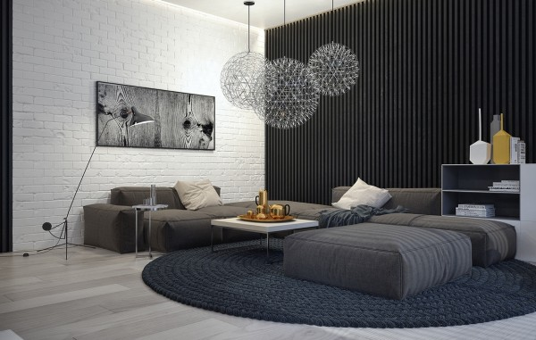 In the second apartment, we see many of the same cool gray colors, including an expansive and cozy sofa in the living room that could easily double as a bed.