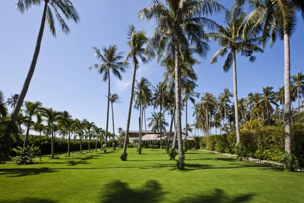 Palm tree plantings and expansive grass keep the villas set back from the road and its inherent noise and traffic.