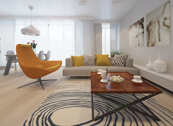 The geometric area rug complements the patterned throw pillows without being overly matchy.