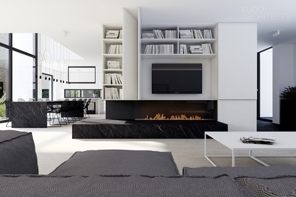 The combination of the sofa and coffee table, both on the same parallel planes, make the room seem to go on forever.