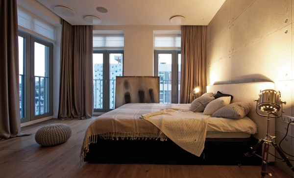 The master bedroom on the corner has city views on two sizes and simple but bold spotlights for a bit of an industrial effect.