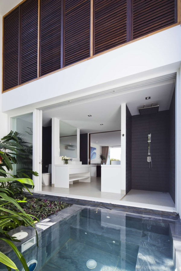 An outdoor shower is a luxurious addition to the outdoor space.