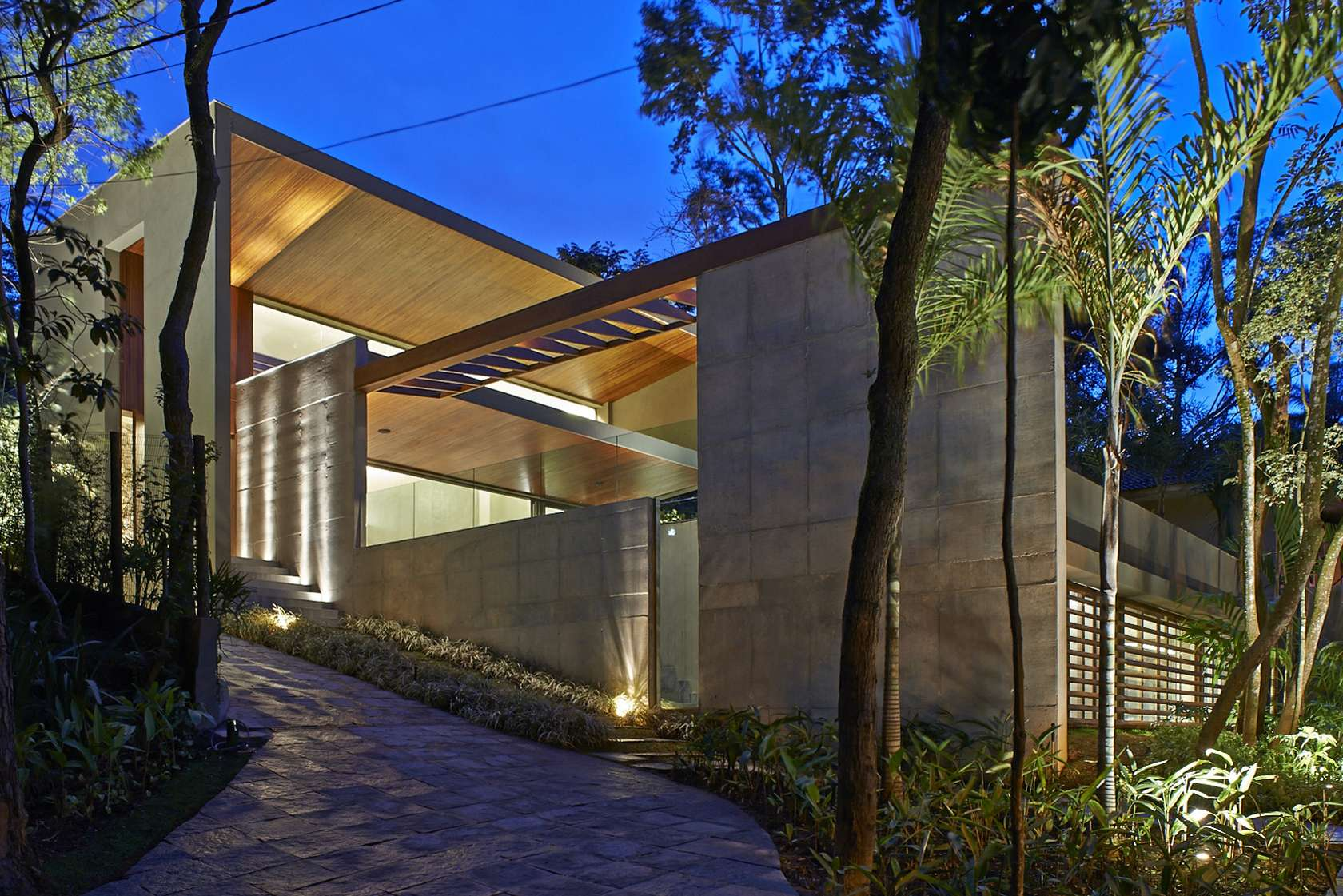 Luxurious Home Uses Wood and Stone Elements to Marry Interiors and ...