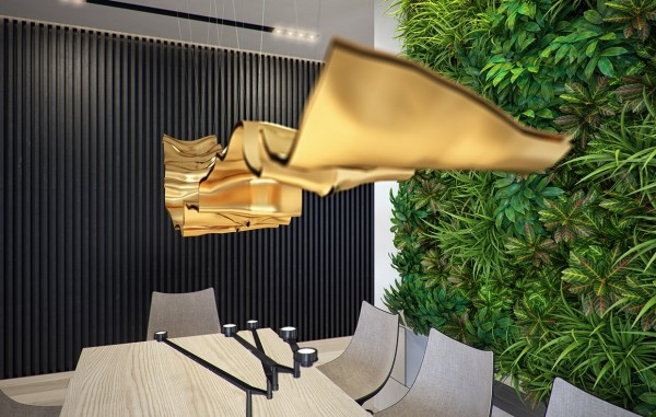 A creative gold ribbon light fixture contrasts beautifully with the plants growing from the wall in a marriage of manmade and natural elements.