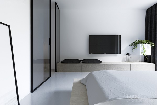 Up a white and lucite staircase we find the bedrooms, which are unsurprisingly simple as well.