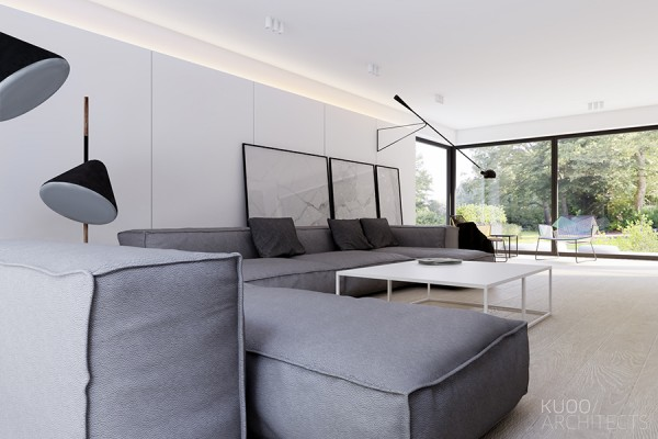In the living room, ample seating can't go unnoticed. A deep and wide sofa makes it easy to bask in the light that filters in from the back wall of windows.