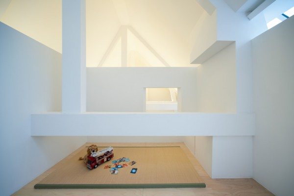 In the perch above the kitchen, a simple playroom also lets in sunlight but is closed off enough that kids can play without fear of taking a tumble.