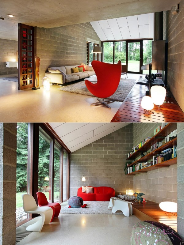 Warm colors are just one way to bring that cozy feeling into a living room. Here, it's pops of a shocking red that contrast the cement bricks and other neutral furnishings for a vibrant, exciting space.