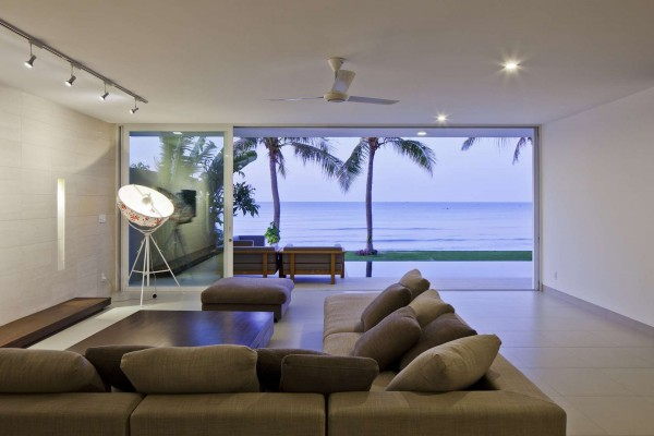 The living room areas are open and sparsely furnished, allowing for all focus to turn to the views.