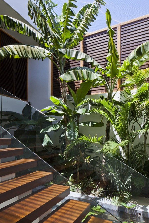 The simple but beautiful wood elements tie together upper and lower level design with the staircase and wood louvers giving the villas an earthy, natural feel while maintaining luxury.