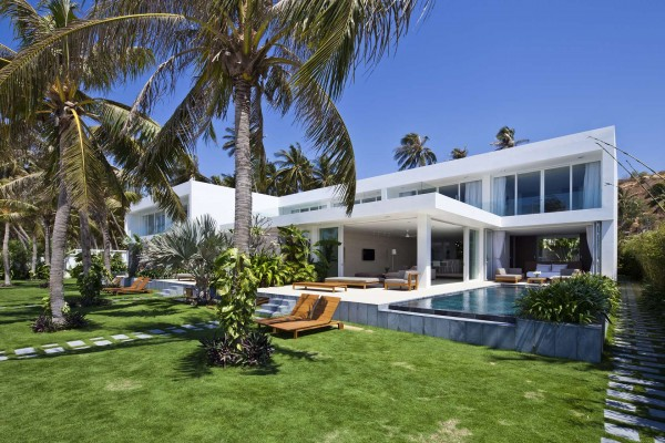 Simple landscaping makes for a comfortable backyard area that also serve to separate the villas from the public beach and crowds.