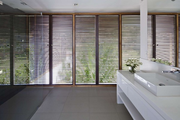 Even the bathroom sinks have access to the gorgeous sea air with the shutter design.