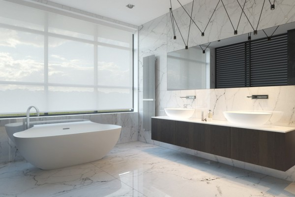 The bath is decidedly luxurious while hanging light fixtures bring a bit of modernity in here, too.