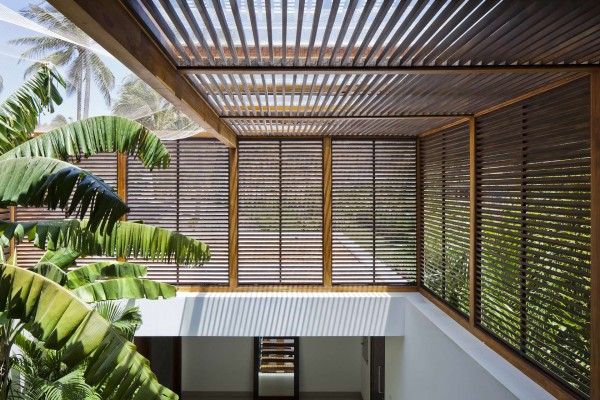 The wooden shutters on the upper levels allow fro enough air flow that air conditioning can be limited to the bedrooms, for a more energy efficient space.