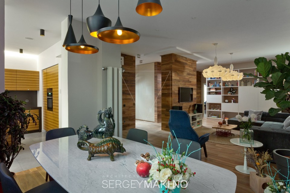 Bronzed Light Fixtures - 3 whimsical apartment interiors from sergey makhno