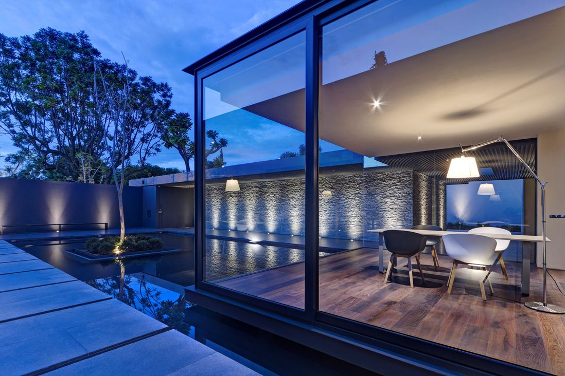 Dark Hardwood Floor - Steel concrete and stone home with central courtyard