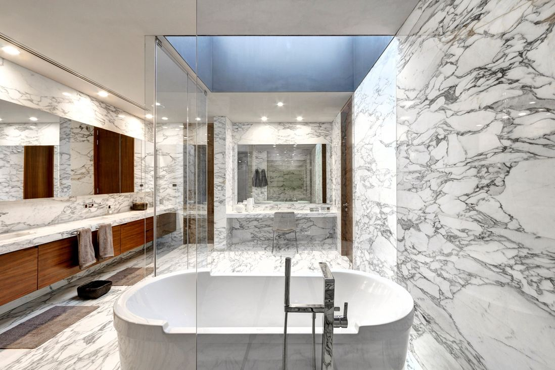 Deep Modern Soaking Tub - Steel concrete and stone home with central courtyard