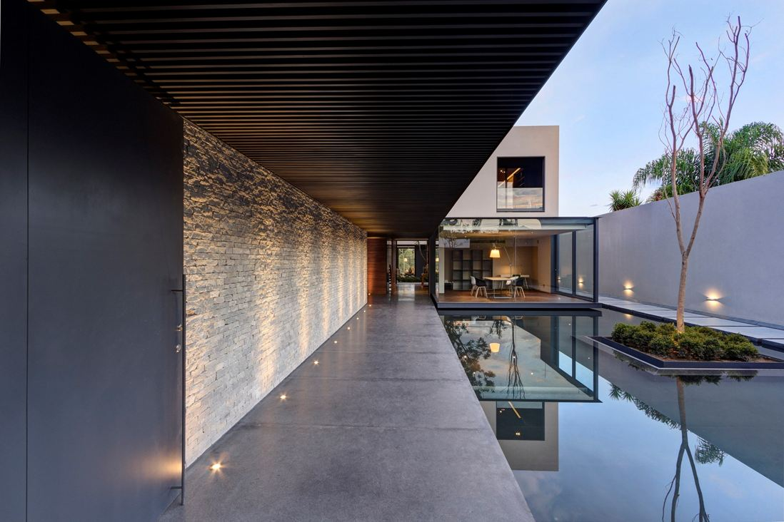 Floor Lighting - Steel concrete and stone home with central courtyard