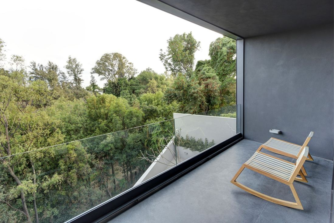 Modern Balcony - Steel concrete and stone home with central courtyard
