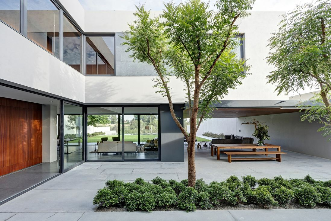 Steel concrete and stone home with central courtyard for Modern courtyard house designs