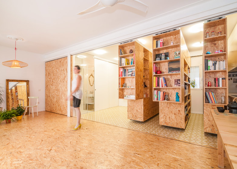 Small Apartment Uses Movable Shelving To Create Endless Design