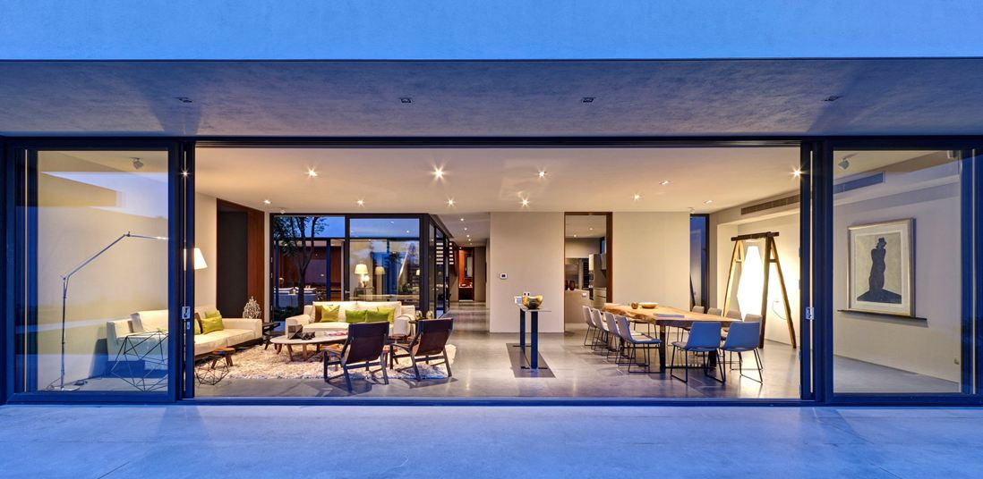 Steel concrete and stone home with central courtyard for Long sliding glass doors