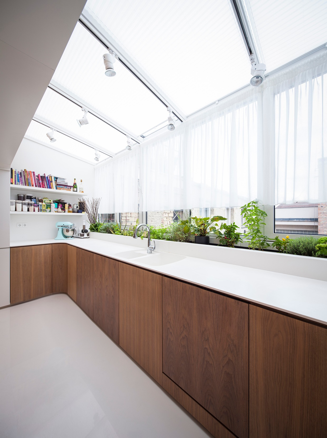 Atrium Kitchen - Hungarian loft design uses a simple aesthetic for big stylish results