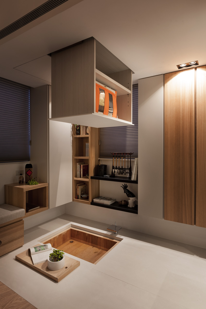 Taipei home showcases asian minimalist influences for Hidden storage ideas