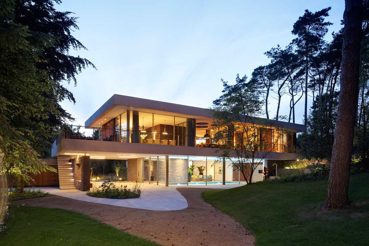 Landscaped Front Yard - Modern exterior complements its gorgeous natural surroundings