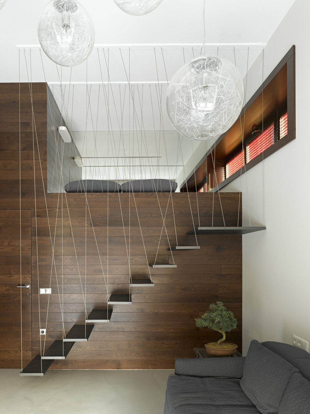 Luxury Lofted Bed Design - Invisible doors turn a home into an artistic feat of design