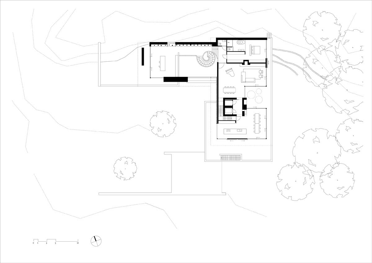 Modern Home Floor Plan - Modern exterior complements its gorgeous natural surroundings