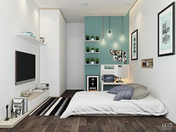 A bold canopy bed may be right for some, but a comfy spot on the floor is enough for others. This simple, quirky bedroom includes a low platform bed and lovely turquoise accent wall. There is something warm, welcoming, and snuggly about the girly decor, too.