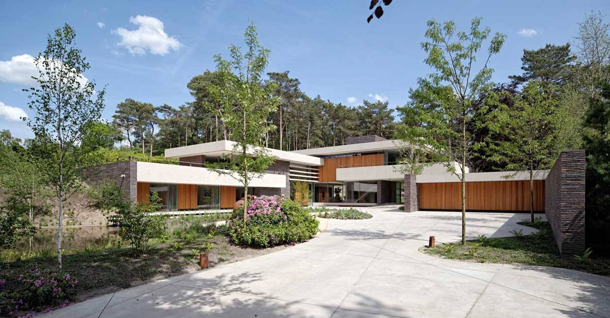 Natural Wood Home Design - Modern exterior complements its gorgeous natural surroundings