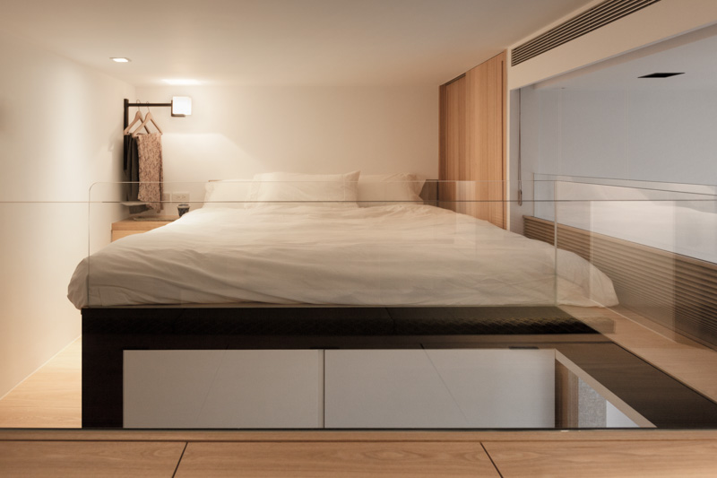 Awesome Upstairs are a lofted private bed area An open glass partition looks out over the living room which may not be the most private arrangement but does allow
