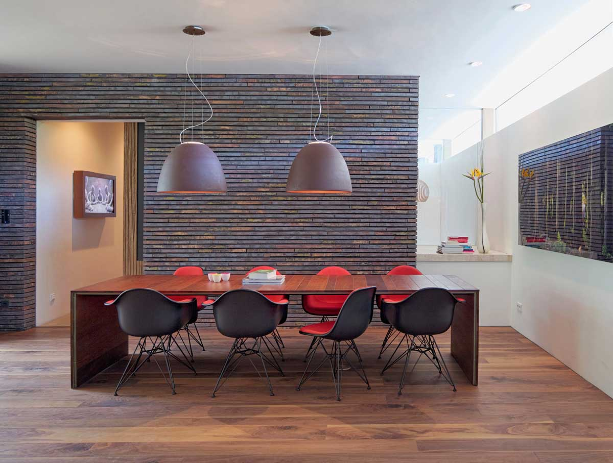 Red Eames Dining Chairs - Modern exterior complements its gorgeous natural surroundings