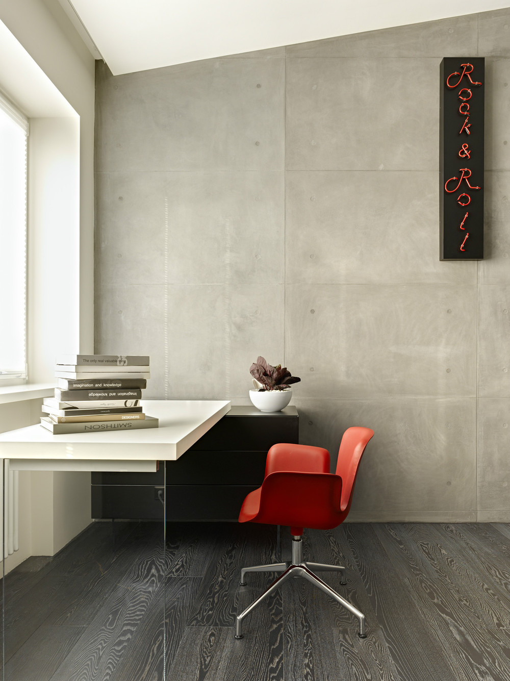 Red Molded Office Chair - Invisible doors turn a home into an artistic feat of design
